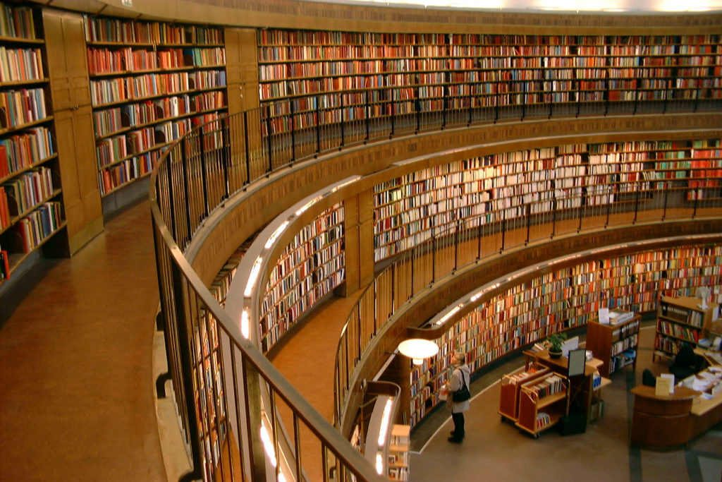 Books on a curving library wall